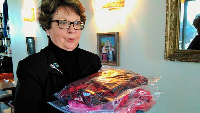 "Judy Meyer is often seen loaded down with packages of women's pajamas as part of a unique North Corridor Rotary Club project known as ""Judy's Jammies."""