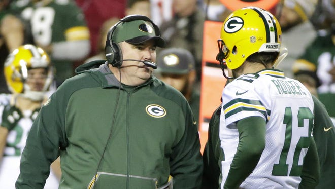 Green Bay Packers quarterback Aaron Rodgers (12) talks with head coach Mike McCarthy on the sidelines at Fedex Field during the game against the Washington Redskins  on Jan. 10, 2016.