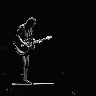 Bruce Springsteen performs onstage with the The E Street