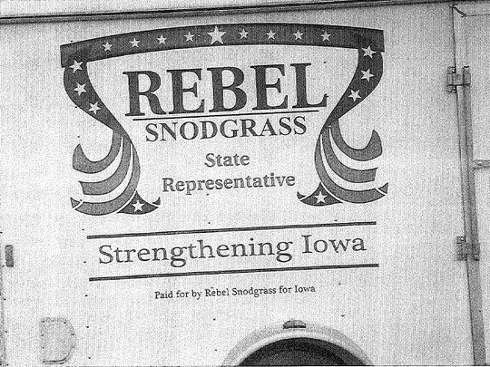 Writing supporting Rebel Snodgrass for State Representative has been printed on the side of a trailer parked at Snodgrass's business, All American Exteriors, in Indianola.