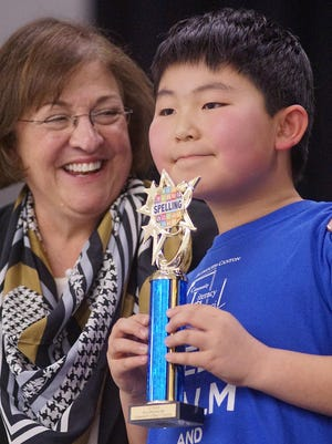 Debbie Cortellini, president of the Literacy Council (here with last year's youth spelling bee winner Andrew Xie), was honored as the 2017 Woman of Distinction.