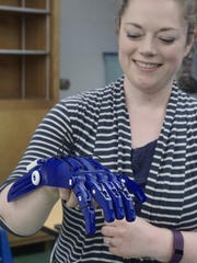 Abbie Pavlov-Bailey and an artificial hand made on