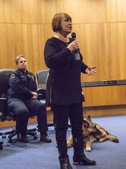 Human traficking surv1vor Joyce Haskett talks about her experience. In the background, Redford Township Police Officer Jen Mansfield and her K-9 partner Maverick.