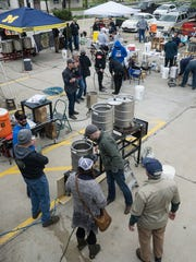 Home and professional brewers gathered to brew in the parking lot of River's Edge Brewing Co. in Milford.