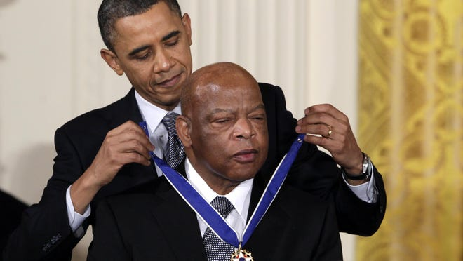 In this Feb. 15, 2011, file photo, President Barack Obama presents a 2010 Presidential Medal of Freedom to Rep. John Lewis, D-Ga., during a ceremony in the East Room of the White House in Washington.