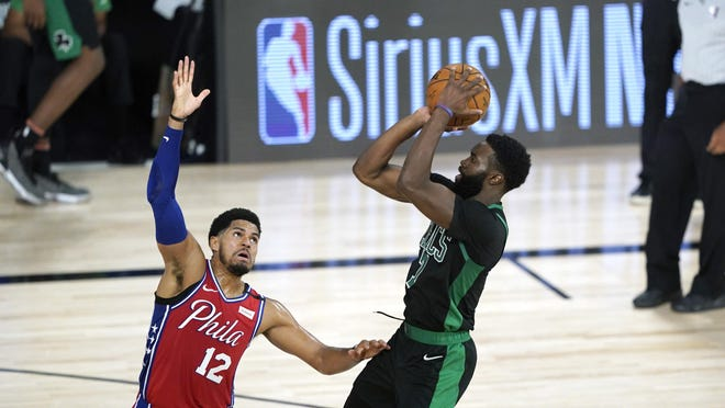 The Celtics' Jaylen Brown goes up for a shot over the 76ers' Tobias Harris during the second half of Monday night's first- round playoff game.