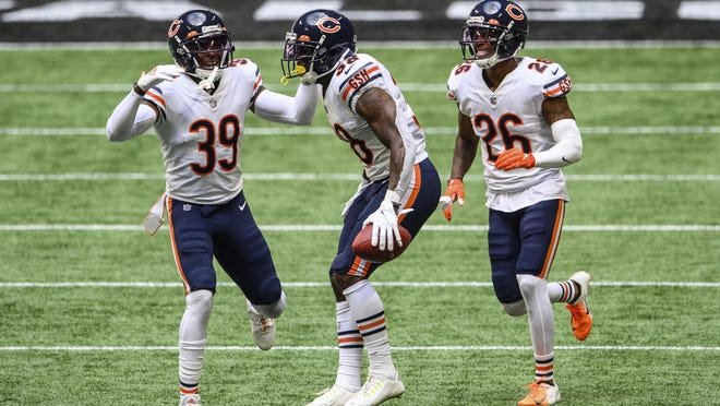Chicago Bears strong safety Tashaun Gipson (38), free safety Eddie Jackson (39), and defensive back Deon Bush (26) celebrate an interception during the second half of an NFL football game against the Atlanta Falcons, Sunday, Sept. 27, 2020, in Atlanta. The Chicago Bears won 30-26.