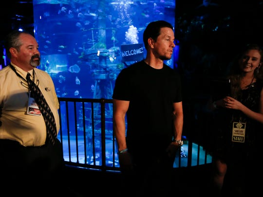 Mark Wahlberg talks to the media before he scuba dives in the shipwreck tank at Wonders of Wildlife National Museum and Aquarium on Wednesday, Sept. 20, 2017.