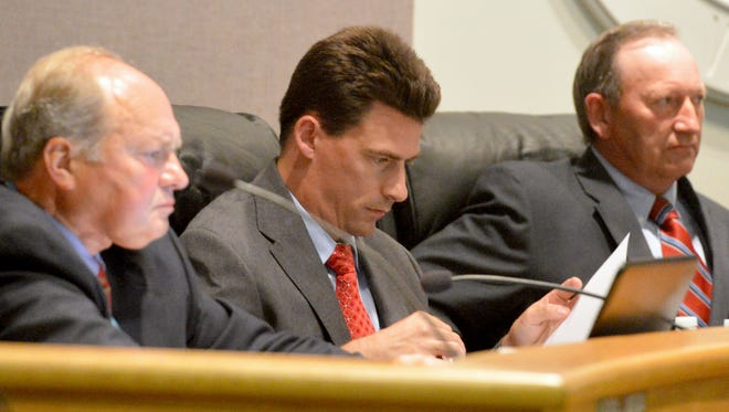 July file photo in which Marshall Pattie looks over a document before the start of a Board of Supervisors meeting.