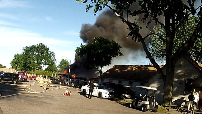 Heavy smoke rise from as the cart barn at Plum Brook Golf Course in Sterling Heights goes up in flames Sunday evening.