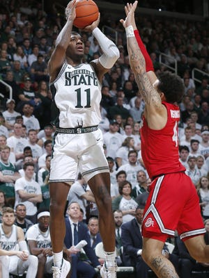 FILE - Michigan State's Aaron Henry, left, shoots against Ohio State's Duane Washington Jr. during the second half of an NCAA college basketball game in East Lansing, Mich., in this Sunday, March 8, 2020, file photo. Michigan State won 80-69. The team will need preseason All-Big Ten player Aaron Henry to produce much more than he has in the past as a role player.