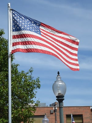 The American flag flutters in the breeze.