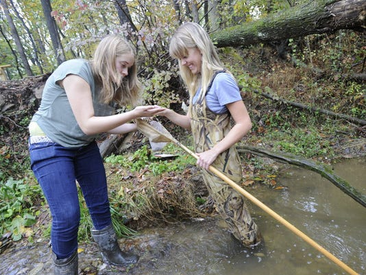 Red Lion students Haley Knapp, left, and Clare Kocman, right,  were part of an advanced placement environmental science class working on studies of Barshinger Creek in the fall. Management of funds for the Barshinger Creek Improvement Project was among the work done by the Red Lion Area Educational Foundation in 2012.