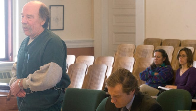 Left, Dennis Tribble of Wolcott, convicted of killing a neighbor 13 years ago, appears on Vermont Superior Court in Hyde Park Dec. 3. Back, second from left, Joanne Borello, widow of Michael Borello who was murdered by Tribble, attended both of Tuesday's hearings.