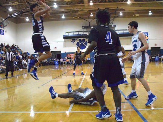 Robert E. Lee's Jarvis Vaughan goes up for a shot against