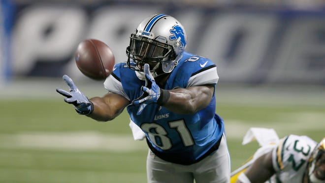 Detroit Lions Calvin Johnson reach pass bringing up a third down and  seven and they ended up with a field goal in the second half of their 27-23 loss to the Green Bay Packers on Thursday, December 3, 2015, in Detroit. Julian H. Gonzalez/Detroit Free Press