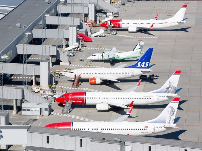 Airplanes line the older domestic terminal at Oslo