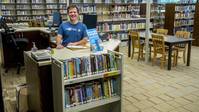 Illinois Prairie District Public Library director Joel Shoemaker stands at the main desk of the remodeled branch opening soon in Roanoke.