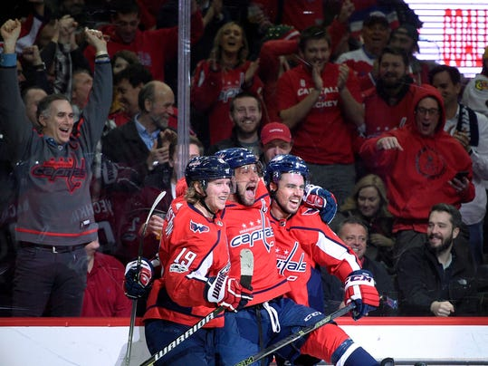 FILE - In this Wednesday, Dec. 6, 2017, file photo, Washington Capitals left wing Alex Ovechkin, center, of Russia, celebrates his goal with center Nicklas Backstrom (19), of Sweden, and defenseman Matt Niskanen, right, during the first period of an NHL hockey game against the Chicago Blackhawks in Washington. Through the first two months of the season, goals are up more than 12 percent from the same time a year ago, including a 14 percent increase on the power play and a 38 percent spike short-handed. (AP Photo/Nick Wass, File)