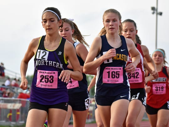 In this GameTimePA file photo, Northern York's Marlee Starliper (left) and Greencastle's Taryn Parks (right) compete in the girls' 3200-meter race at the 2017 PIAA District 3 track & field championships. Both girls raced at the 2017 Foot Locker National Championships in California Saturday.