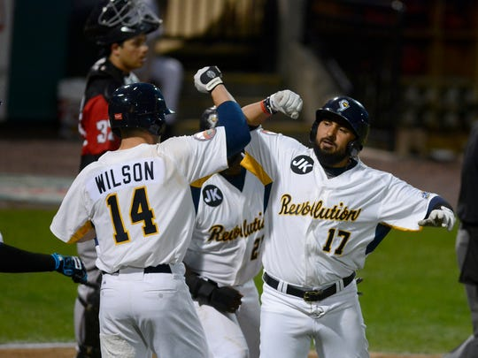 Ryan Dent, right, seen here in a file photo after hitting a 2018 homer, is one of the key returning players for the York Revolution in 2019.