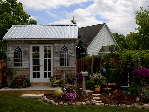Vintage accents beautify the gardens and garden shed at the home off Lori Tatar-Staszak and her husband Pat Staszak in Green Bay on Monday, July 14, 2014.