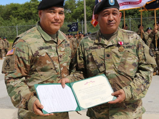 Brig. Gen. Roderick R. Leon Guerrero, left, adjutant general of the Guam National Guard, presents a Meritorious Service Medal to Lt. Col. Emmanuel Escaba during a change of command ceremony on Oct. 14 at the Guard's Readiness Center in Barrigada.