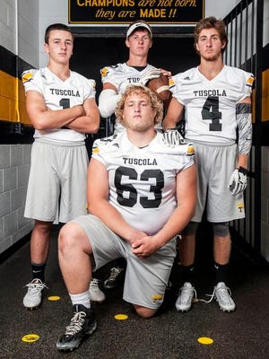 Tuscola football players Caleb Ferguson, Zach Webster, Jordan Davis and Roman Jenkins.