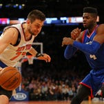 Knicks center Andrea Bargnani (77) drives to the basket against 76ers center Nerlens Noel (4) during the second half Sunday at Madison Square Garden.