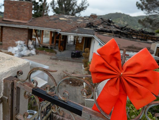 One of several homes destroyed by a wildfire on Lauren Sand's street in the Bel Air section of Los Angeles last December. The pre-dawn blaze raced up a hillside before most residents realized they were in danger. No one was killed, but few were prepared.