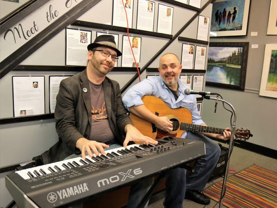Dave Thomas and Josh Smith provide live music during