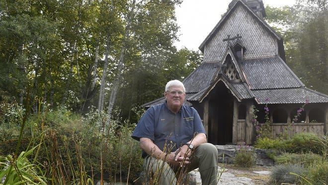 "Washington Island-based writer and historian Richard Purinton has published a new book,, """"Island Stavkirke: The Story of Washington Island's Norwegian Replica,"" on the construction and history of the island's famed Scandinavian-style chapel shown behind him that he and other volunteers built."