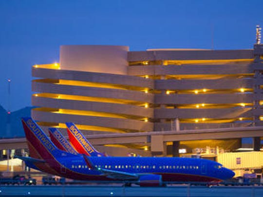 Southwest Airlines planes sit outside Terminal 4 at