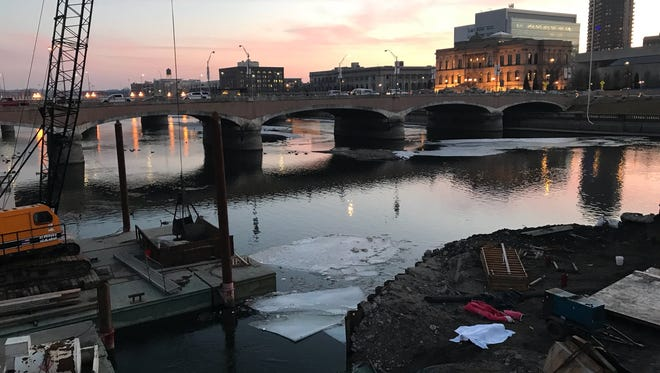 Authorities pulled the body of a male from the Des Moines River near the Grand Avenue Bridge in downtown on Wednesday, Jan. 24.