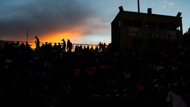 Fans shuffle around in the stands in a TSSAA football game between University School of Jackson (USJ) and Haywood County High School at Haywood High School Stadium in Brownsville, Tenn., on Friday, Aug. 31, 2018.