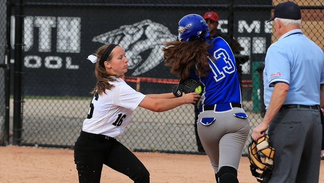 Slapping a tag on Lakeland runner Teresa Menzel (No. 13) is Plymouth freshman pitcher Jenny Bressler (No. 16).