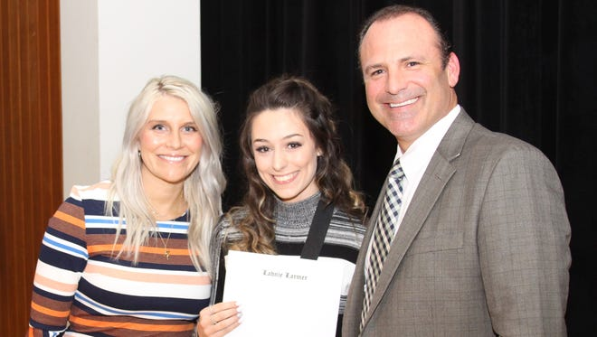 Alana Larmer, center, earned a $1,000 scholarship from the Parkview Leadership School. At a ceremony, she was honored by Callie Sitton, who will be coordinator of the program starting in the 2018-19 year, and Parkview Principal Eric Ramsey.