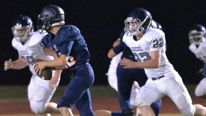 Siegel sophomore Mason Loupe (22) is shown pursuing a Summit football player during the Rutherford County Football Jamboree.