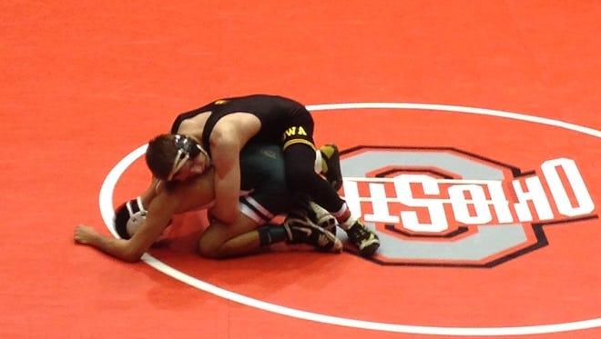 Iowa's Josh Dziewa (top) won by major decision against Michigan State's Javier Gasca III at 141 pounds.
