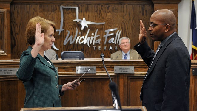 Wichita Falls City Clerk Tracy Norr swears in Romeo Montez III as the new District 5 City Councilor Tuesday morning. Montez was chosen from a field of four local residents who applied for the position.