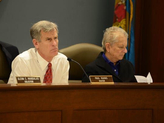 Paul Kuhns, Mayor of Rehoboth, listens as citizens