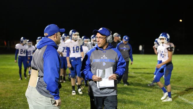 St. Paul head coach Tony Smith, center, and the Buckaroos defeat Santiam 29-27 in a Tri-River Conference game on Friday, Oct. 7, 2016, at Santiam High School in Mill City.