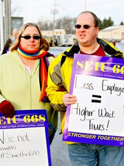Recently furloughed state workers Amy Jensen, left,