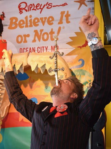Sword swallower Tyler Fyre entertains the crowd at