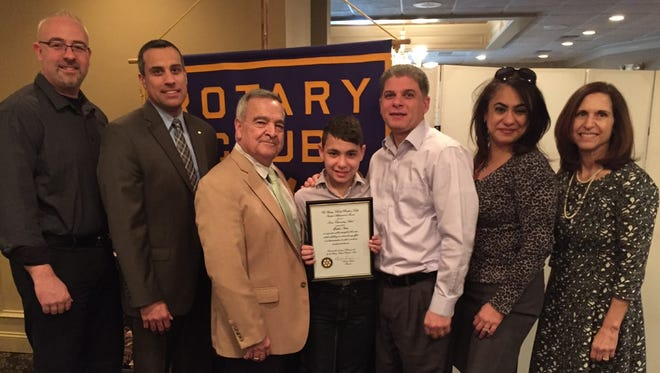 Pompton Lakes Lenox School fifth-grader Mathew Basta is presented the Rotary Club of Pompton Lakes prestigious Student Achievement Award by Rotary Club President Garry Luciani. Joining him at the celebratory luncheon where he was the guest of honor were, from left, his teacher Mike McCarthy, Superintendent of Schools Dr. Paul Amoroso, Luciani, his parents, Nabil and Lidia Basta, and his school Principal Helen Tardif.