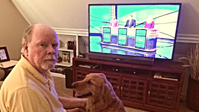 "Knoxville author Michael Grant and his dog, Beau, are both ""Jeopardy!"" fans. On May 21, Michael and his wife, Elizabeth, were stunned to see that Michael was a ""Jeopardy!"" clue."