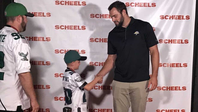 Dallas Goedert shakes hands with an Eagles fan Thursday night at the District