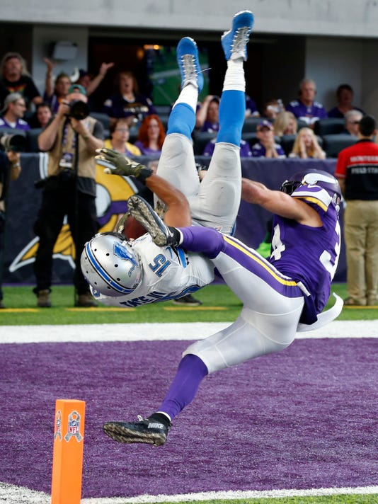 FILE - In this Nov. 6, 2016, file photo, Detroit Lions wide receiver Golden Tate (15) flips into the end zone in front of Minnesota Vikings strong safety Andrew Sendejo, right, after catching a 28-yard touchdown pass during overtime in an NFL football game in Minneapolis. The Vikings remember well the feeling of a crushing loss, thanks to the Lions in an overtime game in Minnesota last fall. . (AP Photo/Jim Mone, File)