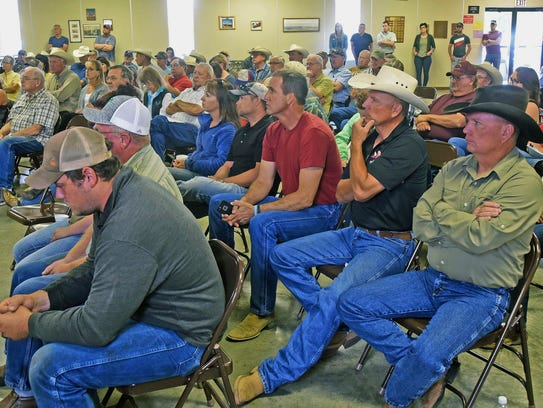 Farmers and ranchers dealing with drought listen during