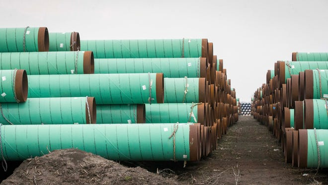 Enormous stacks of pipe stand in March, just east of Newton, Iowa, that are ready to be used as part of the Bakken pipeline.